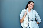Charming young girl with handbag - Copyspace