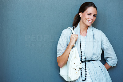 Buy stock photo Charming young girl with handbag - Copyspace