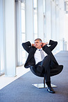 Senior business man relaxing on a chair at a hallway