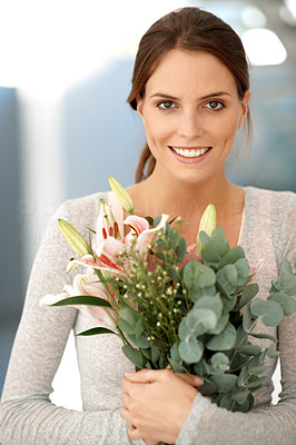 Buy stock photo Attractive brunette holding bunch of flowers