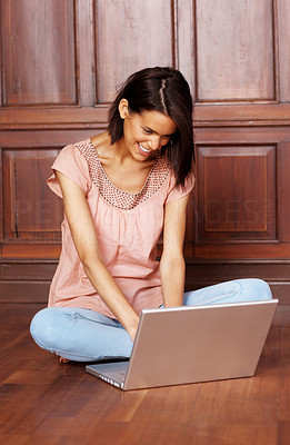 Buy stock photo Charming young female browsing internet with lapto