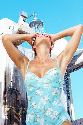 Attractive woman taking a shower