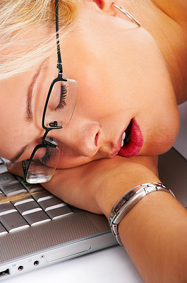 Buy stock photo Shot of a young woman asleep on her laptop keyboard