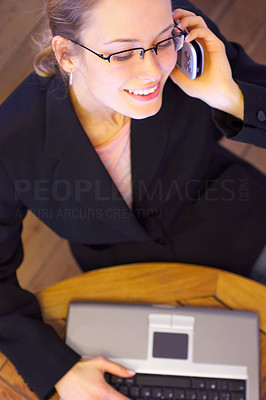 Buy stock photo A fashionable young business woman with a mobile p