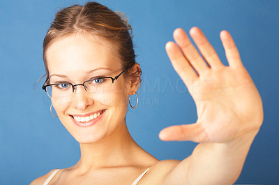 Buy stock photo Confident young woman saying STOP