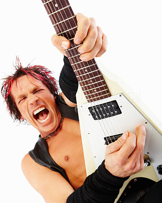 Excited rockstar playing his electric guitar isolated on white background
