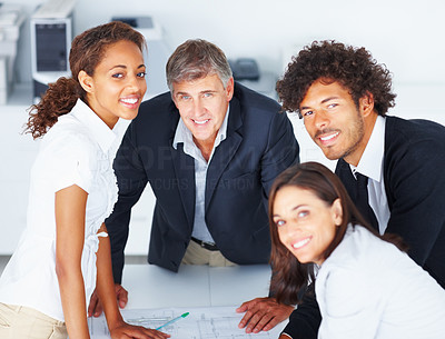 Group of happy business people working together on a project