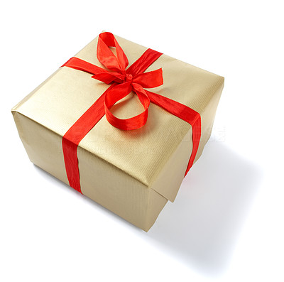 Buy stock photo Christmas present wrapped in gold with a red ribbon, isolated on white - copyspace