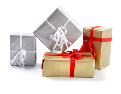 Buy stock photo A group of christmas presents isolated on white - copyspace