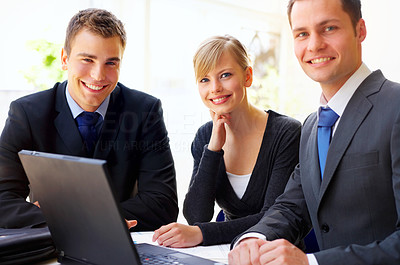 Buy stock photo Portrait of a group of corporate businesspeople working on a laptop