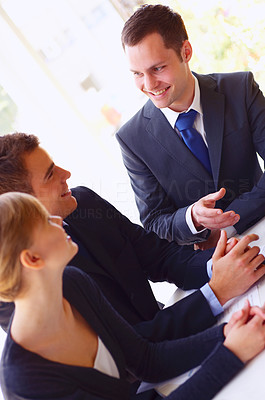 Buy stock photo Cropped shot of a group of corporate businesspeople talking together