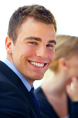 Buy stock photo Portrait of a young executive with a colleague in the background