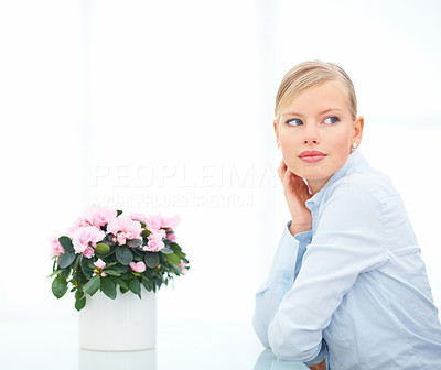 Portrait of beautiful female with flower vase on the table