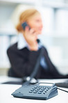 Blurred image of a businesswoman using telephone