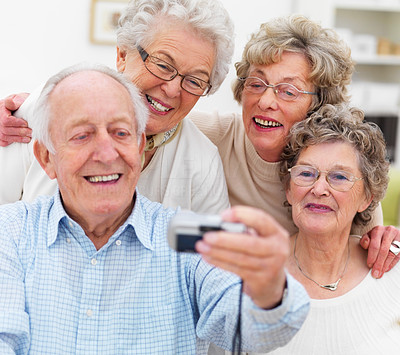Group of mature people taking self portrait