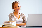 Young happy girl using laptop against white background