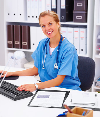Medical - friendly doctor smiling in office