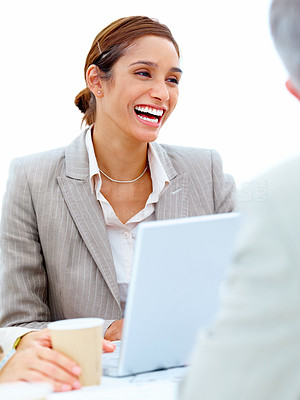 Laughing business female using laptop