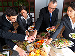 Business lunch - Group of businesspeople eating lunch