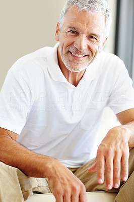 Buy stock photo Relaxed senior man sitting confidently