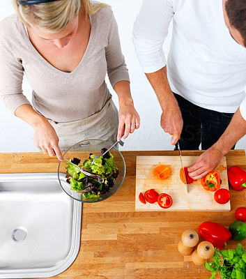 Young couple preparing food in a kitchen