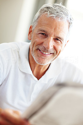 Buy stock photo Happy mature man reading a newspaper