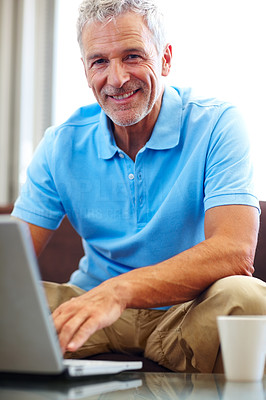Buy stock photo Handsome senior man using a laptop
