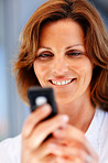 Pretty young female text messaging on mobile