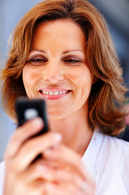 Buy stock photo Beautiful young lady text messaging on mobile