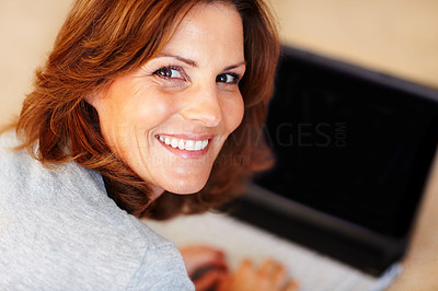 Buy stock photo Happy young woman with a laptop at home