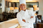 Smiling cook with arms crossed