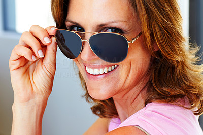 Buy stock photo Happy young woman looking through glasses