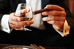 Male hands holding cigar and cognac