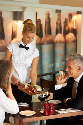Waitress serving food to the customers