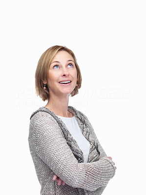 Buy stock photo Pretty middle aged woman looking up over white bac
