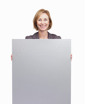 Buy stock photo Happy lady holding blank board isolated over white