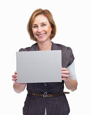 Buy stock photo Happy woman holding blank billboard against white