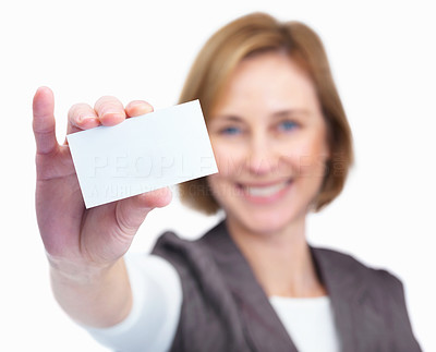 Buy stock photo Happy mature female showing blank business card