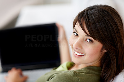 Buy stock photo Happy young brunette using a laptop