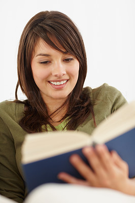 Buy stock photo Happy young female reading a novel