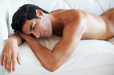 Buy stock photo Portrait of a nude young man lying on sofa and thinking - Indoor