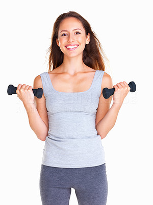 Buy stock photo Woman using dumbbells to work out her biceps while smiling radiantly at the camera, isolated on white - copyspace