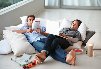 Buy stock photo Young couple relaxing at home