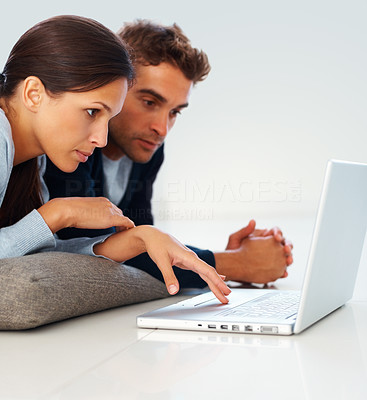 Buy stock photo Handsome man and woman indoors working on laptop