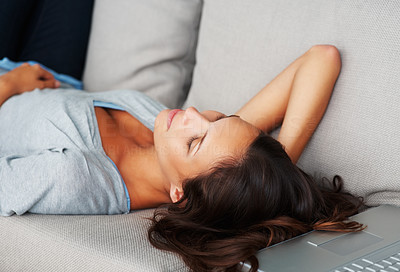 Buy stock photo Pretty woman lying on sofa with eyes closed