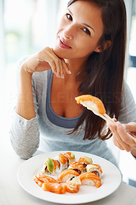 Buy stock photo Pretty woman smiling and holding sushi with chopsticks