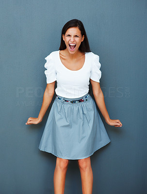 Buy stock photo Angry woman against blue background