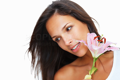 Buy stock photo Head shot of pretty woman holding a flower while looking away