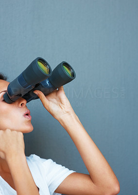 Buy stock photo Side view of pretty woman looking through binoculars against blue background