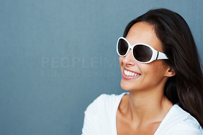 Buy stock photo Pretty woman wearing sunglasses smiling and looking away